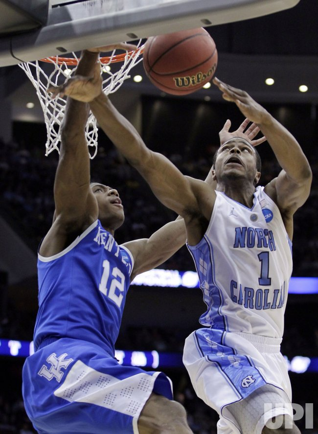 North Carolina Tar Heels Dexter Strickland is defended by Kentucky Wildcats Brandon Knight at the NCAA East Regional Round at the Prudential Center in New Jersey