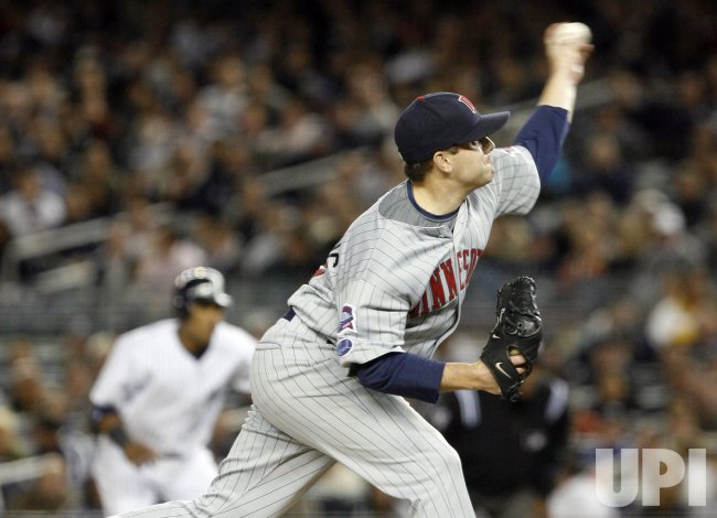 Minnesota Twins starting pitcher Brian Duensing throws a pitch against the New York Yankees in game 1 of the ALDS at Yankee Stadium in New York