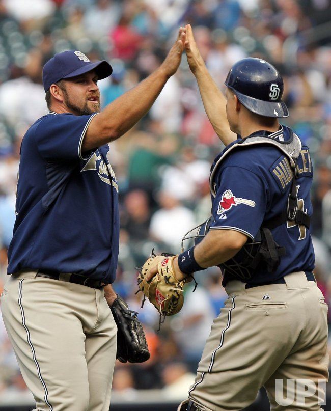 San Diego Padres relief pitcher Heath Bell and catcher Nick Hundley react at Citi Field in New York