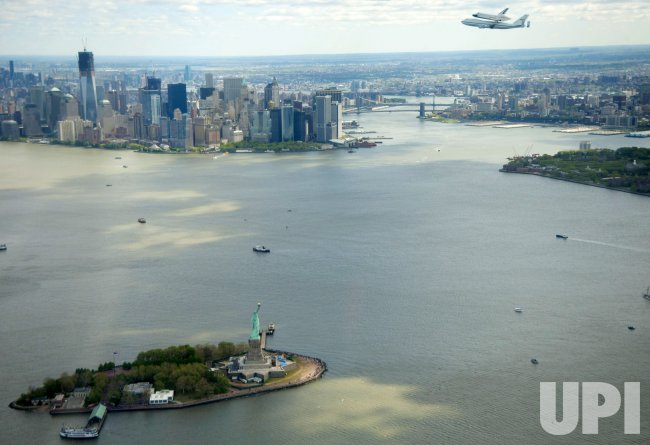 Space shuttle Enterprise flies over New York