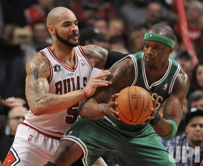 Celtics O'Neal posts on Bulls Boozer in Chicago