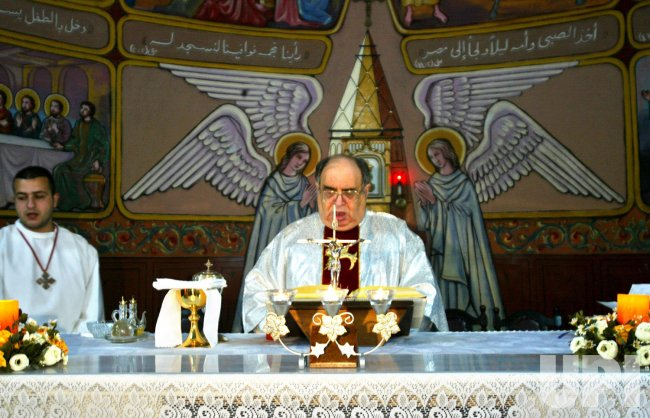 PALESTINIAN CATHOLICS PRAY FOR THE LATE POPE JOHN PAUL II