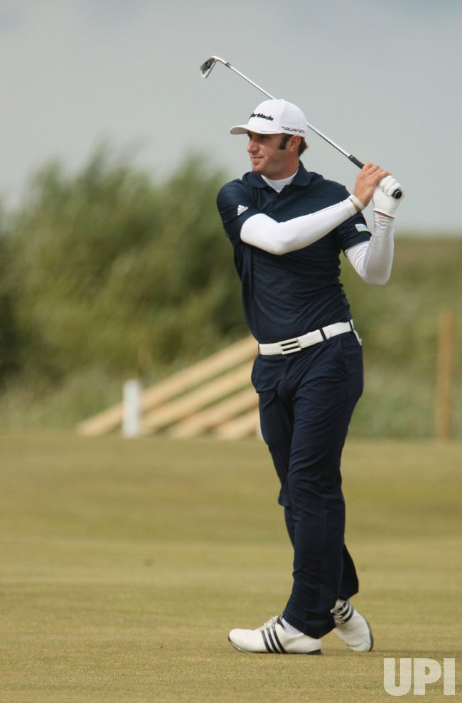 Dustin Johnson plays a fairway iron during the Open Championship in England.