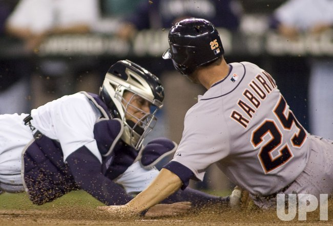 Seattle Mariners' catcher Josh Bard (L) tags out Detroit Tigers' Ryan Raburn, who was thrown out while trying to score from third in the first inning.