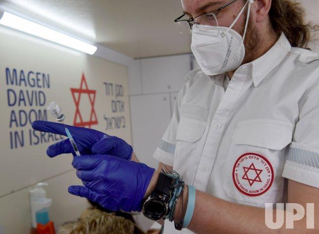 A Paramedic Prepares A Dose Of The Pfizer-Biotech Coronavirus Vaccine In Jerusalem