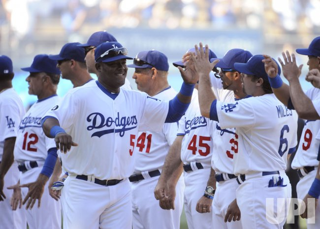 The Los Angeles Dodgers Juan Uribe is introduced before play against the San Francisco Giants on opening day at Dodger Stadium in Los Angeles