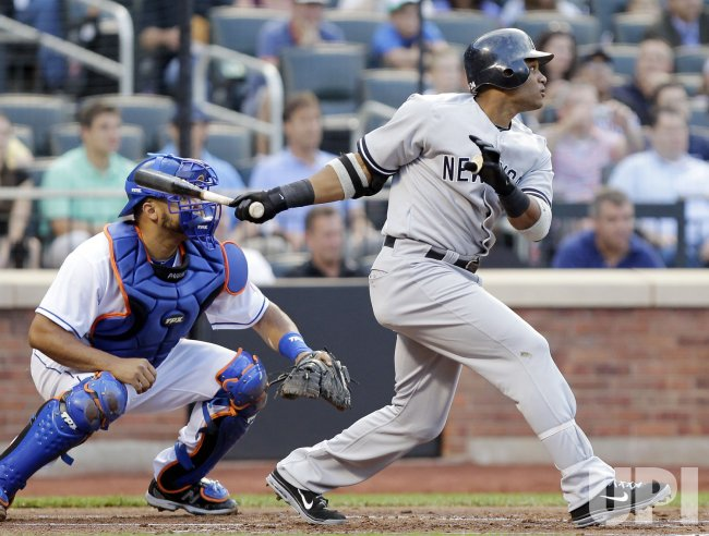 New York Yankees Robinson Cano hits an RBI double at Citi Field in New York
