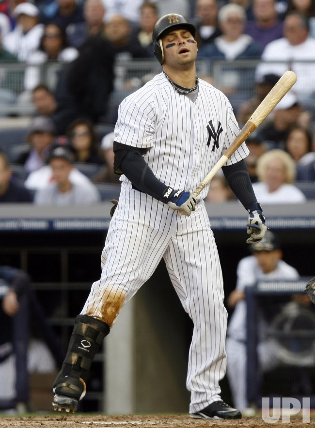 New York Yankees Nick Swisher reacts after a strike call against the Boston Red Sox at Yankee Stadium in New York