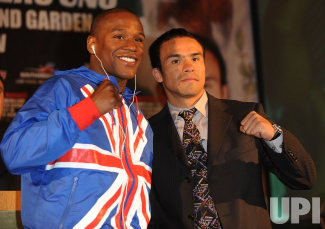 Floyd Mayweather and Juan Manuel Marques attend press conference in London