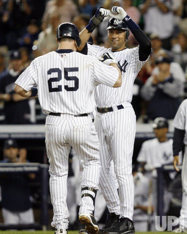 New York Yankees Derek Jeter meets Mark Teixeira against the Tampa Bay Rays at Yankee Stadium in New York