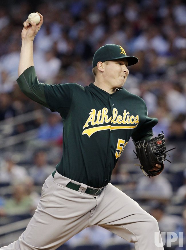Oakland Athletics starting pitcher Trevor Cahill throws a pitch at Yankee Stadium in New York