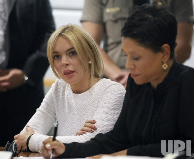 Lindsay Lohan pleads not guilty to felony grand theft charge in Los Angeles