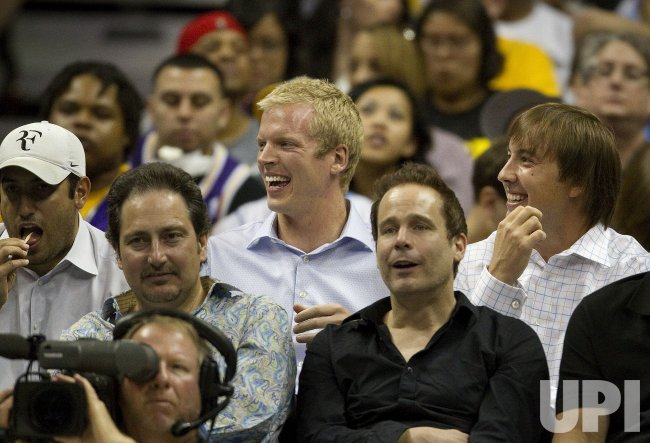Broncos Quarterbacks Orton and Simms Watch Nuggets Play the Lakers in Denver
