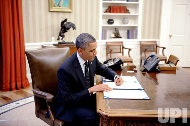 President Obama signs H.R. 2747 and S. 893, in Washington, D.C.