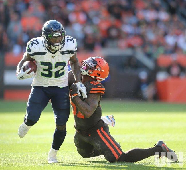 Seahawks Carson drags Browns Wilson