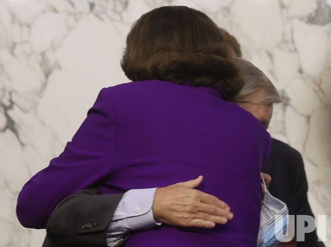 Feinstein Congratulates and Hugs Graham after Supreme Court Hearings