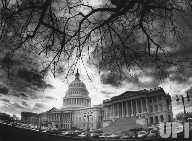 The U.S. Capitol under a stormy cloud cover