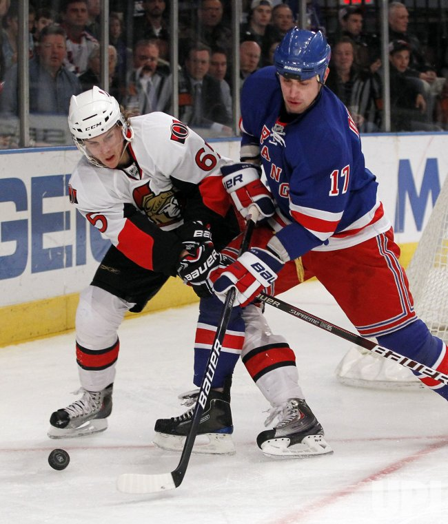 New York Rangers Filip Kuba and Ottawa Senators Erik Karlssonat Madison Square Garden