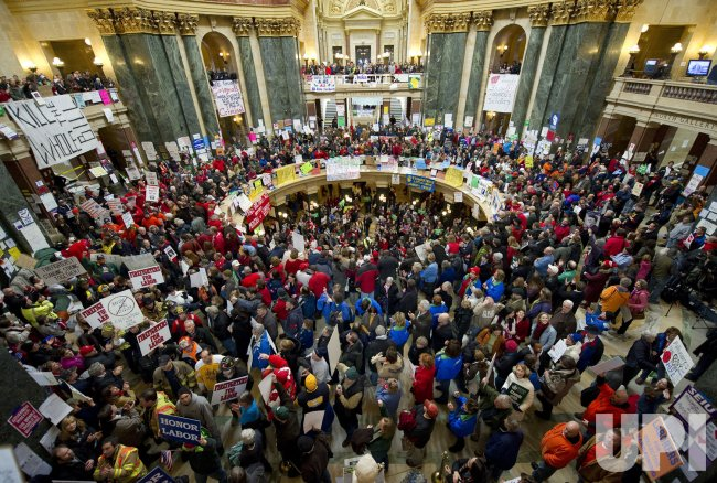 Protesters crowd rotunda in state Capitol in Madison, Wisconsin