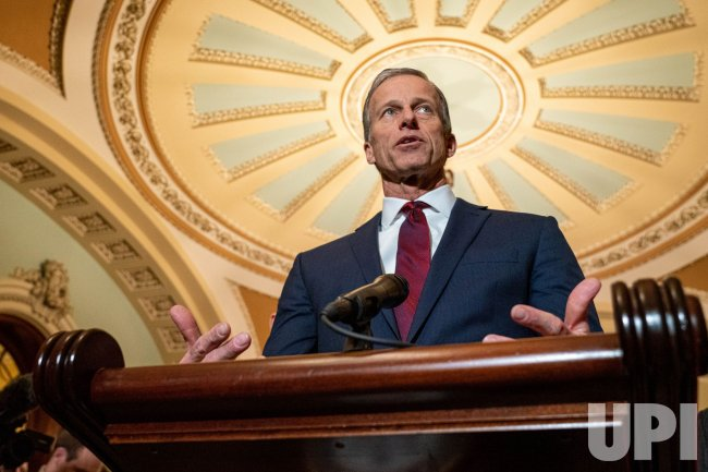 U.S. Sen. John Thune speaks to press