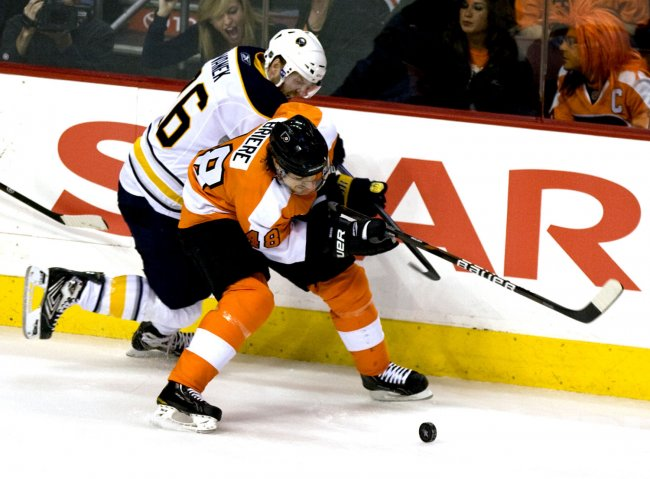 Flyers Danny Biere battles Sabres Thomas Vanek for the puck during second period in Philadelphia.