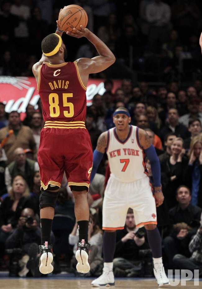 New York Knicks Carmelo Anthony watches Cleveland Cavaliers Baron Davis shoot at Madison Square Garden in New York