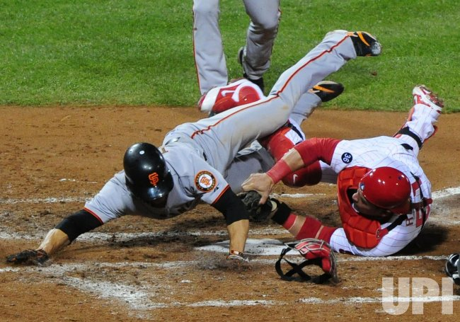 Phillies' Carlos Ruiz tags out Giants' Andres Torres during game 6 of the NLCS in Philadelphia