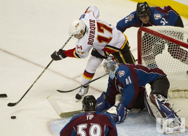 Flames Bourque Shoots Against Avalanche Goalie Anderson in Denver