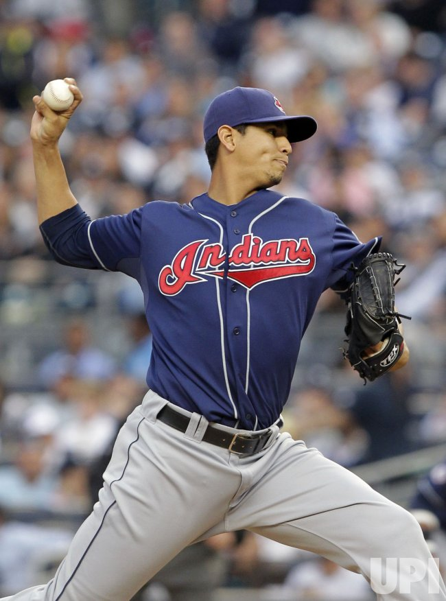 Cleveland Indians starting pitcher Carlos Carrasco throws a pitch at Yankee Stadium in New York