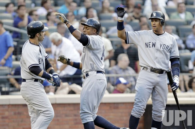New York Yankees Nick Swisher, Curtis Granderson and Alex Rodriguez react at Citi Field in New York