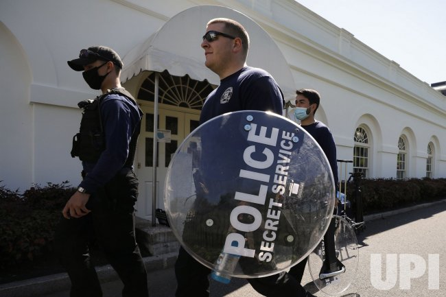 Secret Service agents carry riot shields at White House in Washington