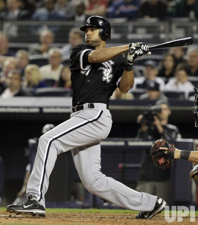 Chicago White Sox Alex Rios hits a single at Yankee Stadium in New York