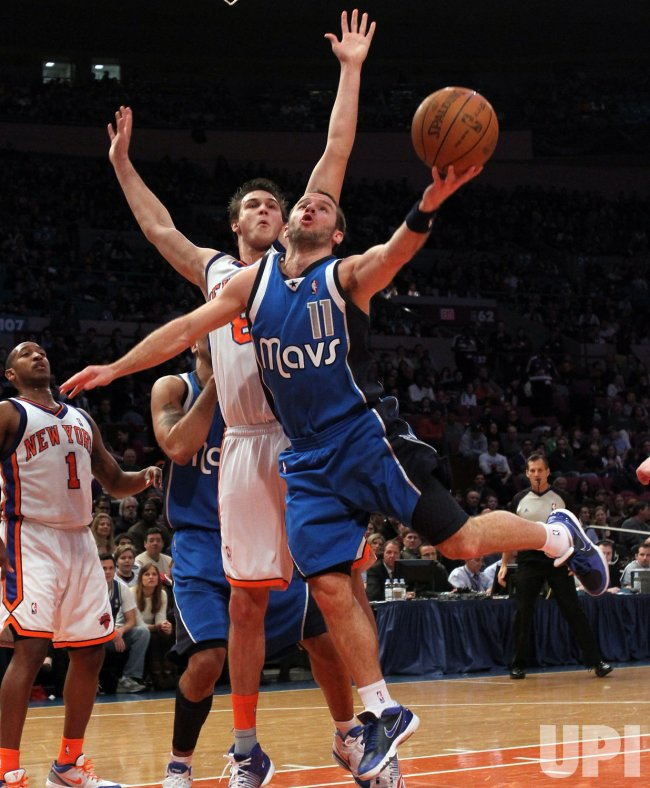 New York Knicks Danilo Gallinari tries to block a shot taken by Dallas Mavericks Jose Juan Barea at Madison Square Garden in New York