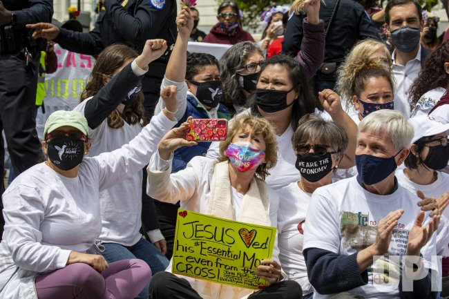"""Immigration """"We're Essential Americans"""" Protest at US Capitol"""