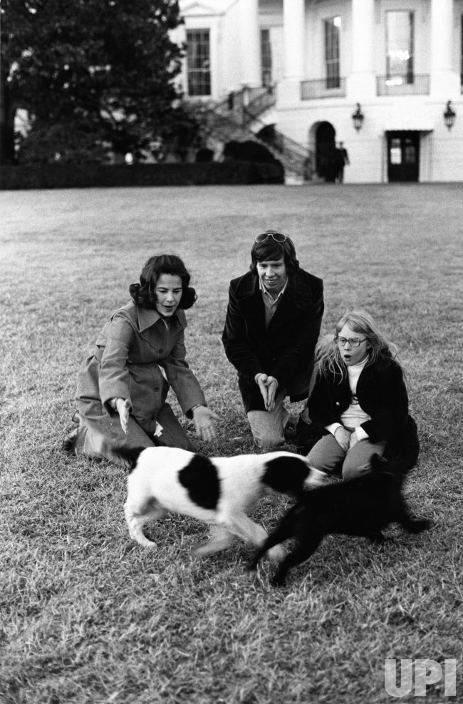 Carter family play with their cat and dog