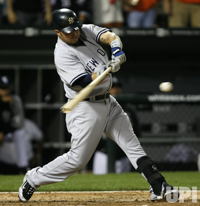 New York Yankees' Nick Swisher homers against the Chicago White Sox