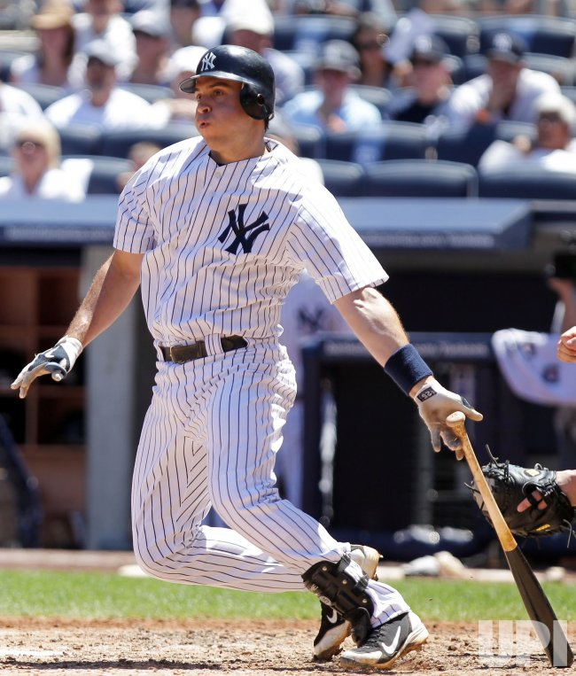 New York Yankees Mark Teixeira hits an RBI double at Yankee Stadium in New York