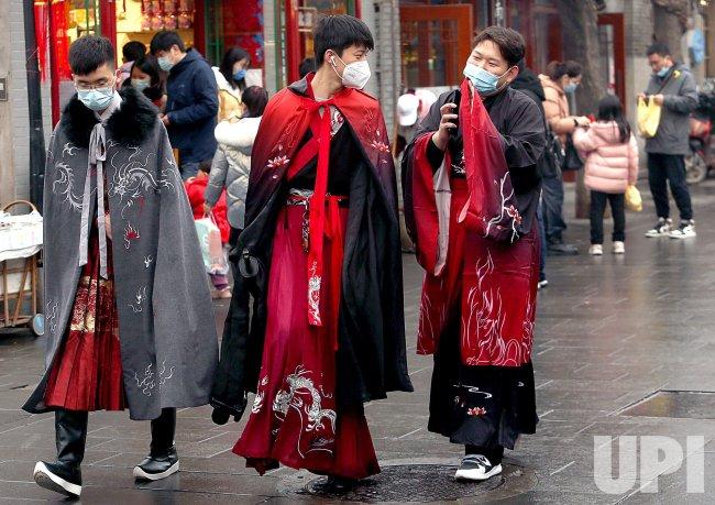 Men Wear Costumes in Beijing, China