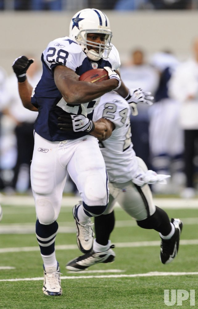 Cowboys Felix Jones runs against the Raiders