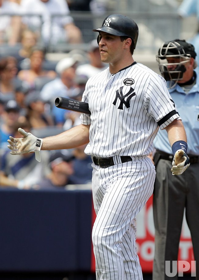 New York Yankees Mark Teixeira reacts after striking out at Yankee Stadium in New York