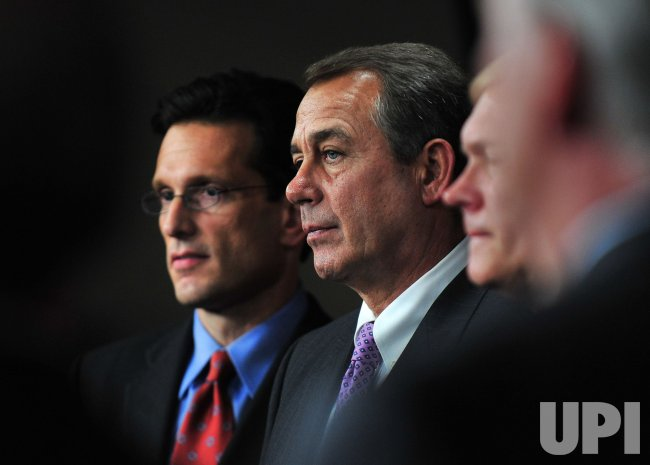 House Majority elect Rep. Eric Cantor and Speaker Elect John Boehner attend a press conference on the 112th Congress in Washington