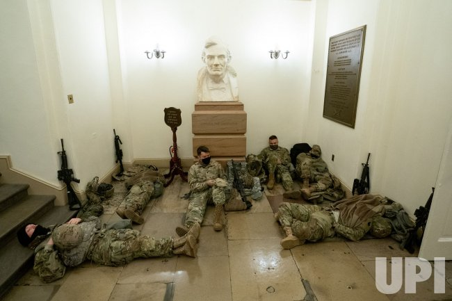 Members of the National Guard sleep inside the U.S. Capitol
