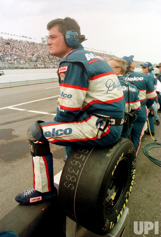 A crew member of the Dale Earnhardt, Jr. racing team, uses a tire as a chair