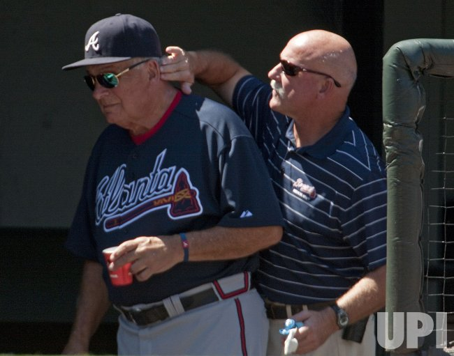 Braves Manager Cox Receives Application of Sun Block in Denver