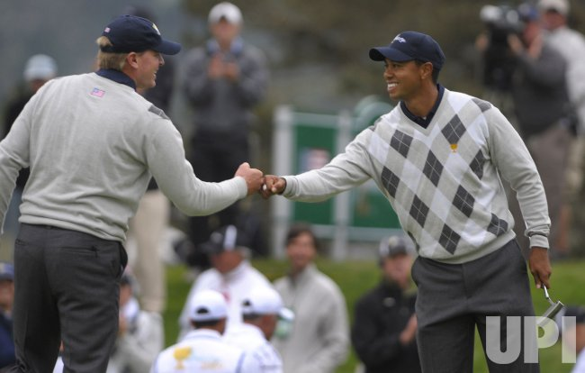 Steve Stricker and Tiger Woods celebrate during the fourth round of the 2009 Presidents Cup in San Francisco