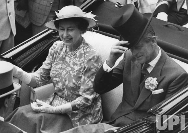 Queen Elizabeth II and Prince Philip arive at the Royal Ascot in an open carriage