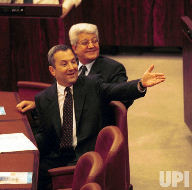 Israeli Prime Minister Ehud Barak and Foreign Minister David Levy in the Knesset as the eighth President of Israel is being sworn in