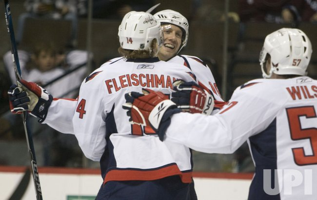 Capitols Fehr and Fleischmann Celebrate Goal in Denver