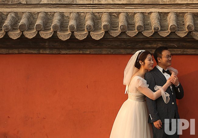 Chinese Newlyweds Pose for Wedding Photos in Beijing, China