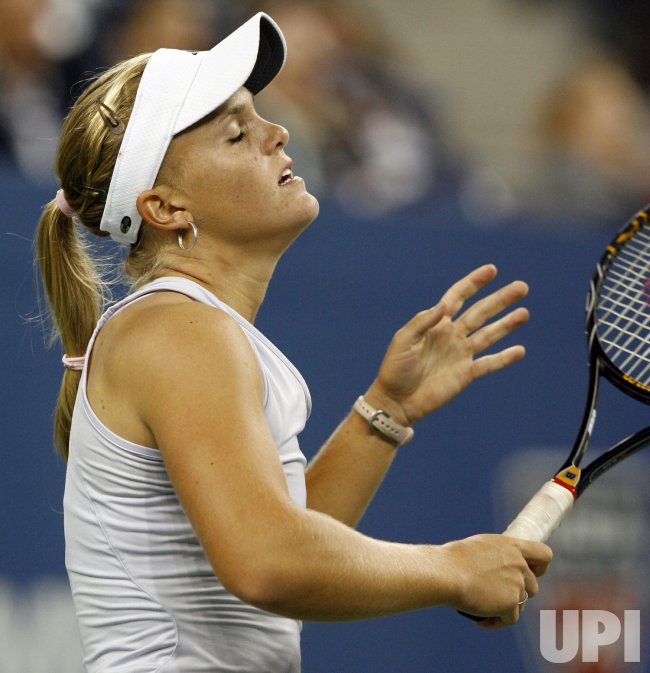 Caroline Wozniacki plays Melanie Oudin in the quarter finals at the US Open Tennis Championships in New York
